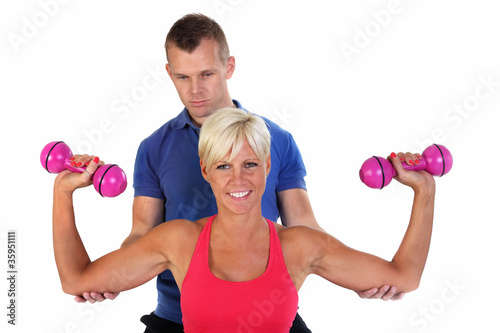 Attractive woman exercising with her coach