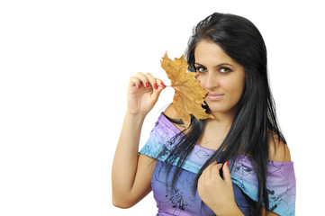Portrait of an young pretty woman holding a leaf on white