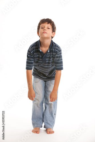 Cute boy with bored expresion on a white background