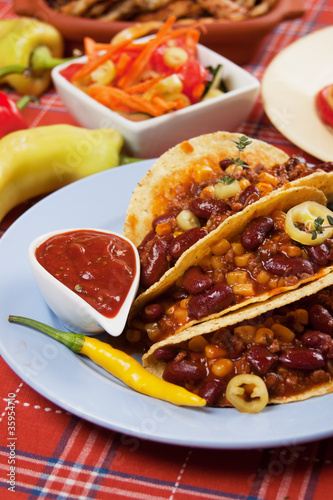 Chili con carne burrito in taco shell
