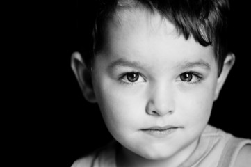 Monochrome portrait of boy with serious expression