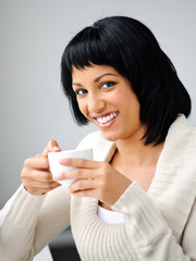 Woman poses with cup