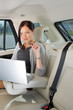 Executive businesswoman work laptop car backseat