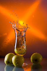 green apples and glass with juice