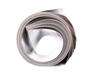 Magazine roll isolated on white