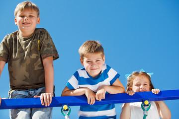 Three kids climbing up