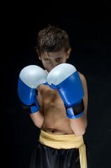 a child boxer in studio.