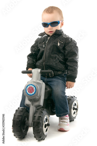 Girl on child's motorcycle