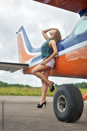 Woman near airplane