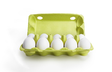 Ten white eggs in a carton box. Isolated on a white background
