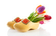 Pair of traditional yellow wooden shoes with colorful tulips