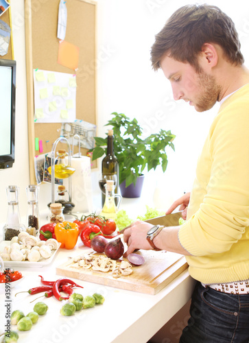 Young man cooking healthy food