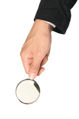 .Brass Magnifying glass in business hand