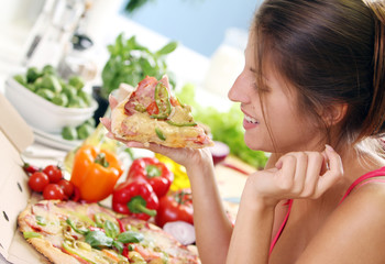 Beautiful woman with pizza