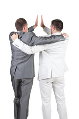 Two joyful businessmen with success gesture . Rear view.