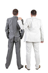 Two businessmen discuss. Rear view.