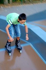 Boy skating from a ramp with motion effect