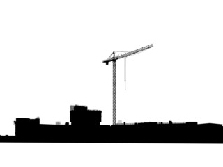 Silhouette of the elevating crane against building