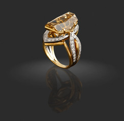 Gold ring with diamonds and gem