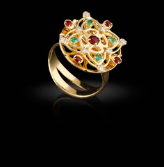 Gold ring with gems on black