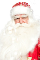 Santa Claus portrait smiling isolated over a white background an