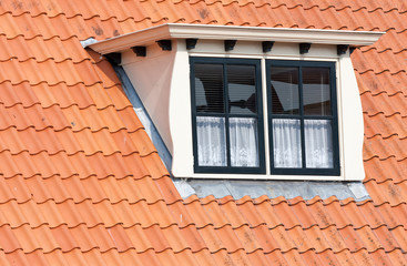 Typical Dutch roof with dormer and squared windows