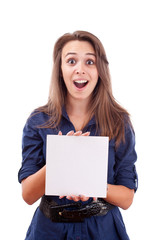 Young woman pointing at blank card in her hand