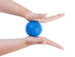 Woman's hands with massage ball