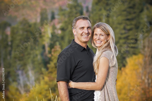 Beautiful Middle-aged Couple Outdoors Portrait - 35985909