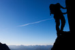 Silhouette of a climber with large copy space