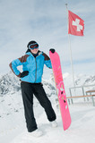 Young snowboarder in Swiss Alps