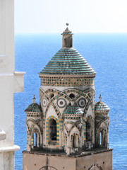 the bell tower of cathedral in Amalfi - Italy - against blue sea
