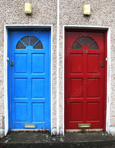 two doors with bright colors at the entrance to a house