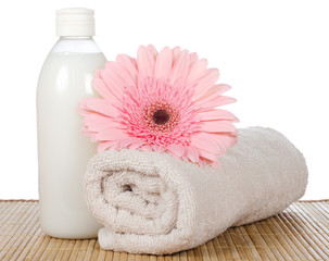 Pink gerbera and a towel