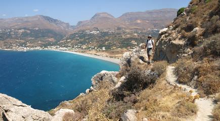 South coast of Crete, young man walking. Plakias, Greece.