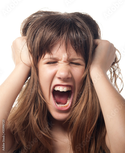 Angry and frustrated teenage girl screaming.
