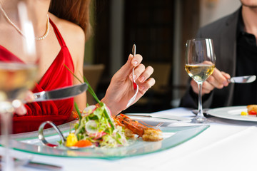 Couple eating and drinking in very good restaurant