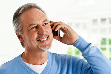 Mature man having a phone conversation