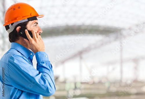 Engineer on the phone in an establishment
