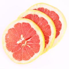 Grapefruit, a sliced half on white background