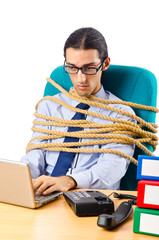 Young businessman tied with rope