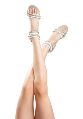 Beautiful women legs in sandals up in the air