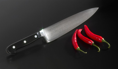 kitchen knife and chillies