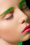 Girl with creative makeup, green eyebrows, pink lips poster