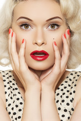 Surprise! Woman with vintage make-up, hairstyle. Pin-up girl