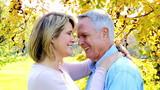 Happy elderly senior couple in park
