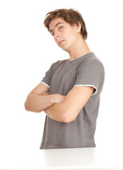 standing young serious man with crossed arms
