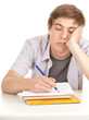 writing young male student with books