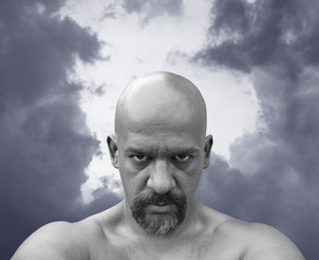 Bald naked man with sinister look in his eyes.