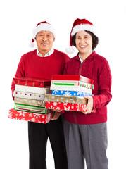 Senior Asian couple celebrating Christmas